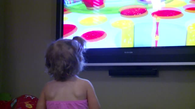 toddler watches mickey mouse clubhouse on toshiba monitor. dances with and waves at mickey - country club stock videos & royalty-free footage