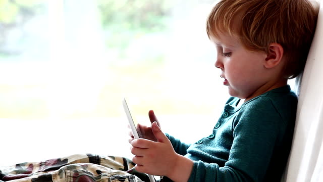 toddler watching digital tablet. - 2 3 years stock videos & royalty-free footage