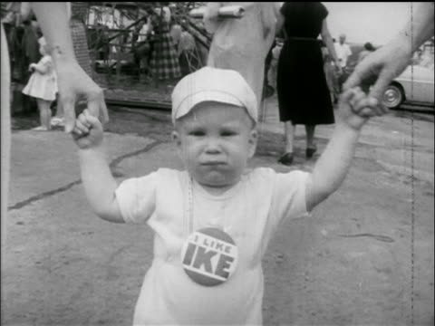 b/w 1952 toddler wearing i like ike campaign button / newsreel - anno 1952 video stock e b–roll