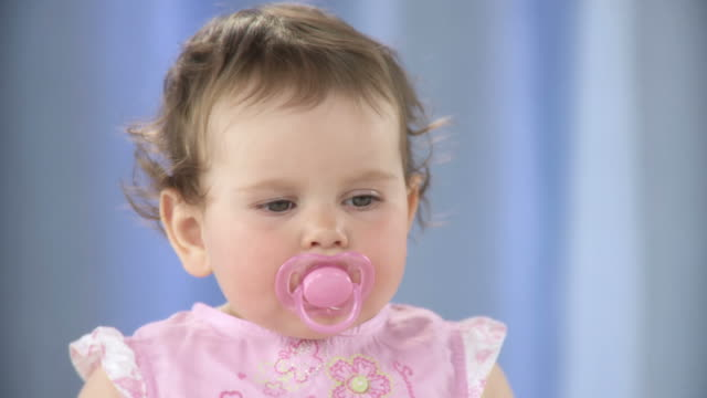 hd: toddler with a pacifier - one baby girl only stock videos & royalty-free footage
