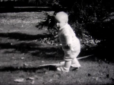 1934 toddler with big rake falls down - 1934 stock videos & royalty-free footage