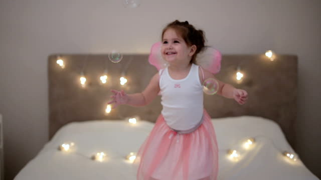 toddler with fairy wings playing in the bedroom. - fairy stock videos & royalty-free footage