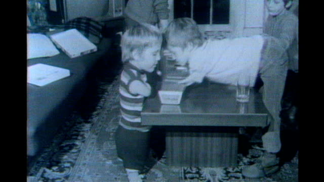 Toddlers playing xylophone together and playing at table