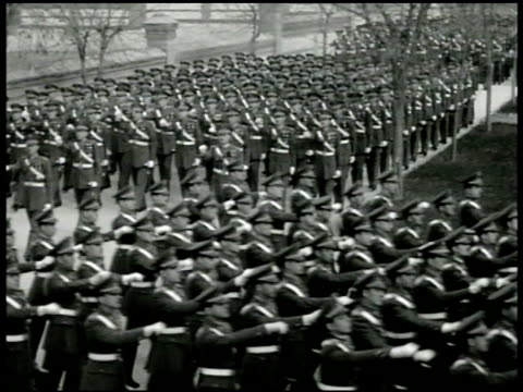 'todo por la patria' sign below crest spanish officers marching in uniform parade formation generalissimo francisco franco w/ others reviewing... - parade stock videos & royalty-free footage