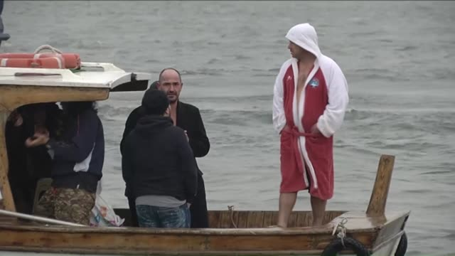 todor pasev, a bulgarian man, retrieved the wooden cross from the bosphorus' golden horn as part of celebrations of jesus christ's baptism and birth,... - キリスト降誕点の映像素材/bロール