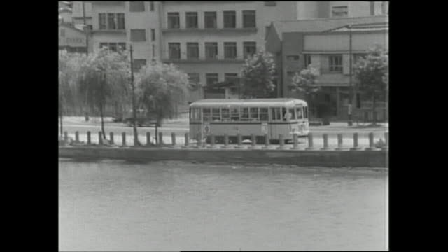a toei streetcar travels past a moat. - moat stock videos & royalty-free footage