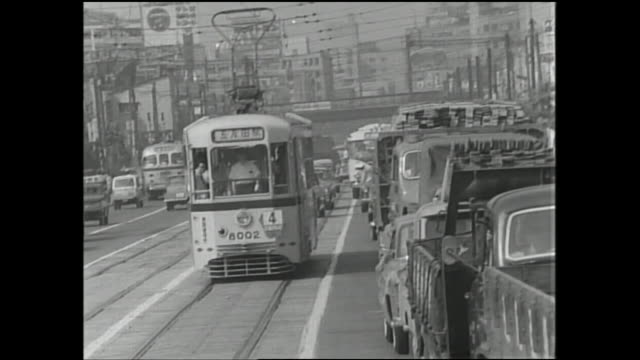 a toei streetcar travels toward the gotanda station. - postwar stock videos & royalty-free footage