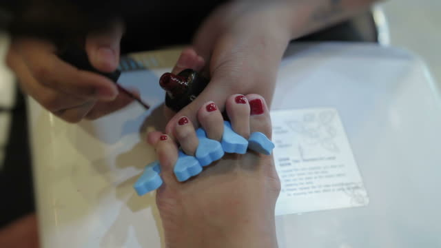 toenail painting spa - painting toenails stock videos & royalty-free footage