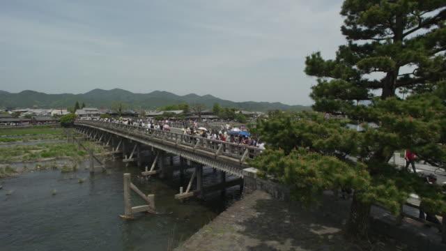 togetsukyo bridge over katsura river in kyoto - kiefer stock-videos und b-roll-filmmaterial