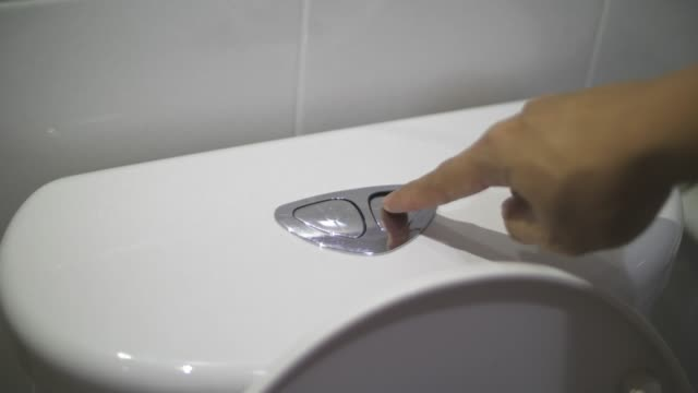 toalett stolen spolning, slo mo - stege bildbanksvideor och videomaterial från bakom kulisserna
