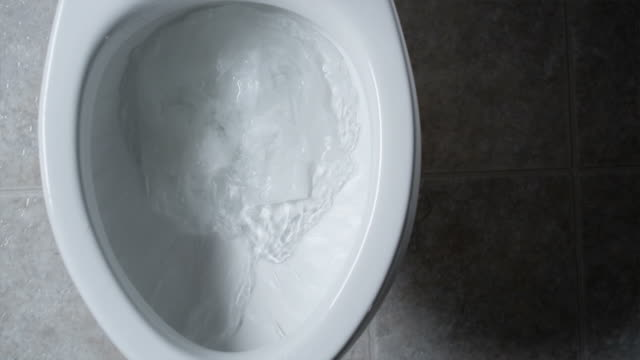 toilet paper clogging up the toilet - overflowing stock videos & royalty-free footage