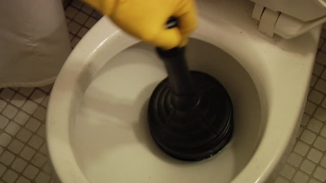 toilet plunger at work - toilet stock videos and b-roll footage