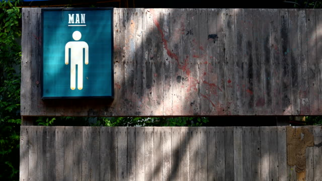toilet sign on wood old wall - public restroom stock videos and b-roll footage