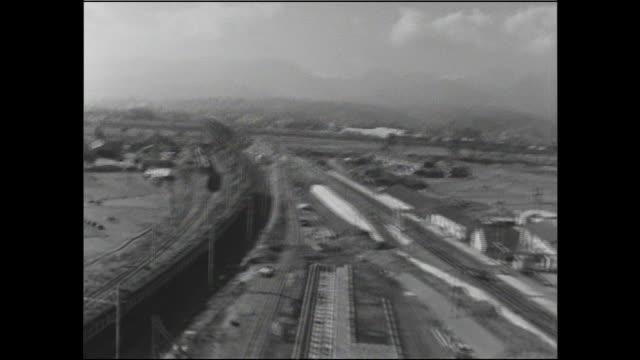 a tokaido main line train approaches a sakawa river bridge in odawara, kanagawa. - shinkansen stock videos & royalty-free footage