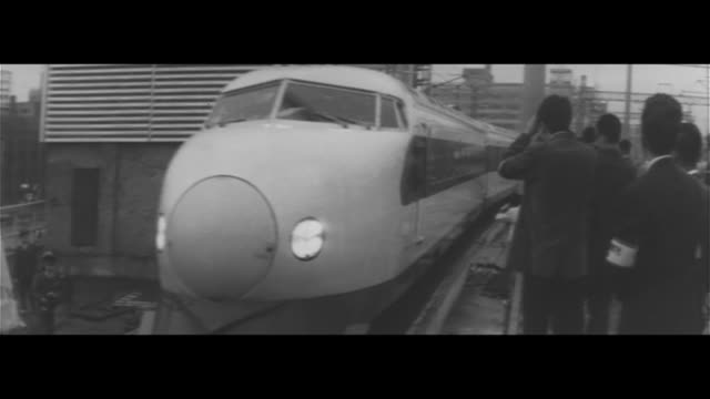 vídeos de stock e filmes b-roll de tokaido shinkansen starts operation/tokaido shinkansen opening ceremony jnr president ishida cuts the tape hikari 1 leaves the station shinkansen... - 1964