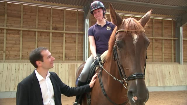 Sophie Christiansen interview UK various shots of Sophie Christiansen along on horse and interview general views of Christiansen with horse...