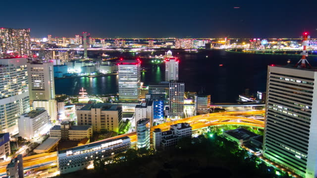 ws t/l tokyo bay area in city at night / tokyo, japan - rx stock videos & royalty-free footage