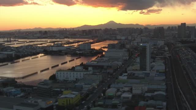 aerial, tokyo bay area with mt fuji in twilight, japan - tokyo bay stock videos & royalty-free footage