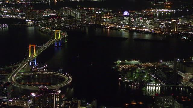 aerial, tokyo bay around illuminated rainbow bridge, japan - kanto region stock videos & royalty-free footage