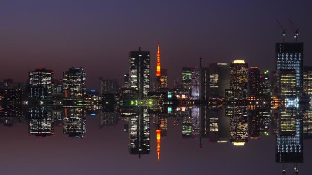 Tokyo bay at dusk mirroring in water