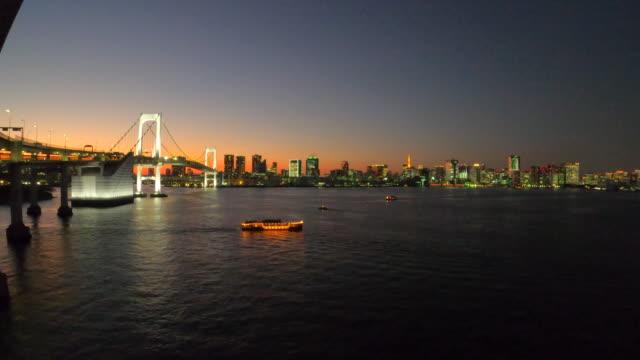 tokyo bay at dusk / rainbow bridge - tokyo bay stock videos & royalty-free footage
