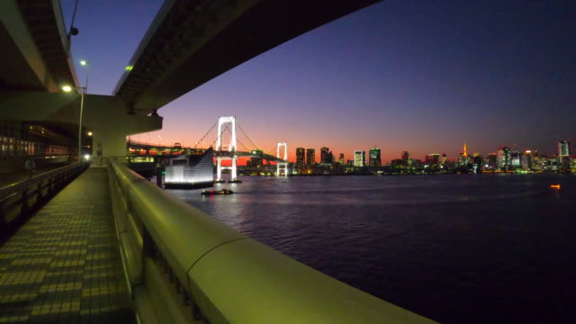 tokyo bay at dusk / rainbow bridge - passenger craft stock videos & royalty-free footage