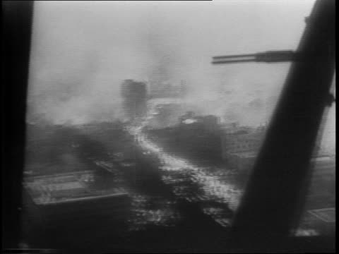tokyo burning after doolittle bombing / air raid sirens wreckage burning in streets smoke / tokyo retaliates by executing american aviators behind... - bombing stock videos & royalty-free footage