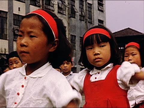 1953 tokyo, children exercising - 校庭点の映像素材/bロール