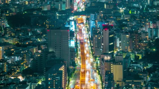 東京市が夜時間の経過で高速道路を閉じる - 高速道路点の映像素材/bロール