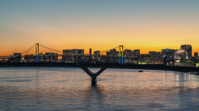 tokyo city skyline from sunset to night, harumi aera, japan, 4k timelapse. - sunset to night time lapse stock videos & royalty-free footage