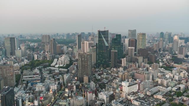 東京の街並、夜タイムラプス ビデオの日 - 昼から夜点の映像素材/bロール
