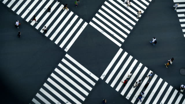 tokyo, ginza. pedestrians crossing the road at all directions simultaneously. - pedestrian crossing stock videos & royalty-free footage