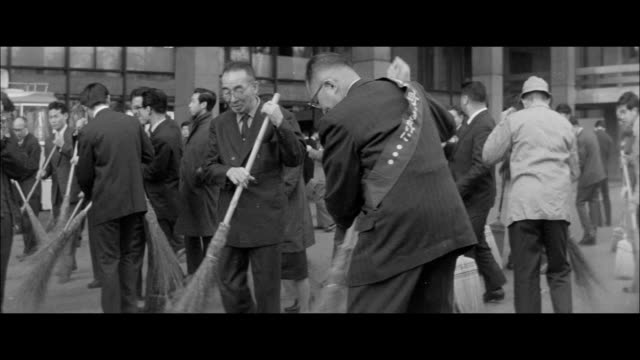 tokyo governor azuma and fellow employees clean the front of the metropolitan office for tokyo beautification day/housewives from taito ward clean... - symbols of peace stock videos & royalty-free footage