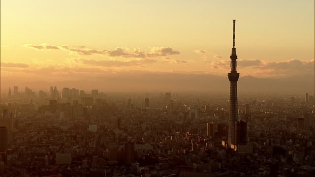 aerial, tokyo in sunset glow, japan - dusk stock videos & royalty-free footage