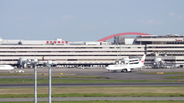 tokyo international airport - western script stock videos & royalty-free footage