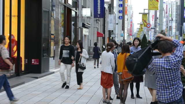tokyo japan local crowds ginza shopping area downtown with rush of locals and tourists shop and walk along famous street - ginza stock videos & royalty-free footage