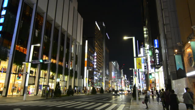 tokyo japan local crowds ginza shopping area walking street at weekend with no traffic downtown with rush of locals and tourists shop and walk along famous street ginza street - ginza stock videos & royalty-free footage