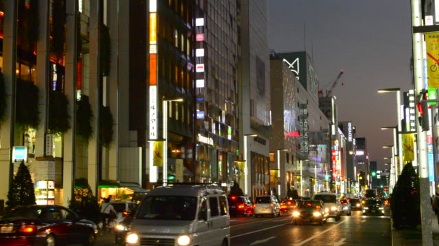 tokyo japan local crowds ginza shopping twilight traffic blurs of movement on street downtown with rush of locals and tourists shop and drive along famous street on ginza street - ginza stock videos & royalty-free footage