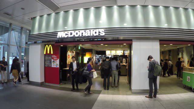 tokyo japan local crowds in tokyo station downtown train station going into mcdonald's restaurant - mcdonald's stock videos & royalty-free footage