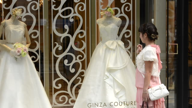 Tokyo Japan local woman wedding dress on Ginza shopping downtown  shop and famous street on Ginza Street