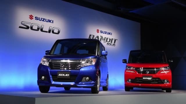 tokyo japan wednesday aug 26 2015 shots wide shot low angle pan left to right suzuki motor corp's solio bandit vehicle sit on display during an... - compact car stock videos and b-roll footage
