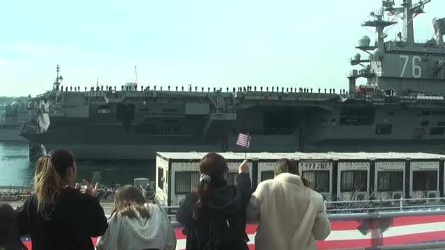 Footage taken on Dec 4 2017 from a Kyodo News helicopter shows the US aircraft carrier Ronald Reagan returning to the Yokosuka naval base south of...
