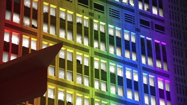 cu, tokyo met gov bldg lit up rainbow, japan - wall building feature stock videos & royalty-free footage
