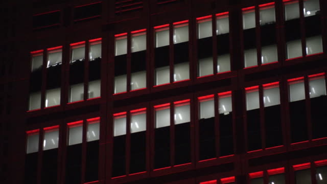 cu, tokyo met gov bldg lit up red, tokyo, japan - wall building feature stock videos & royalty-free footage