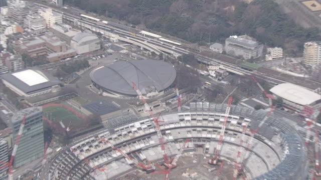 aerial, tokyo metropolitan gymnasium, japan - オリンピックスタジアム点の映像素材/bロール