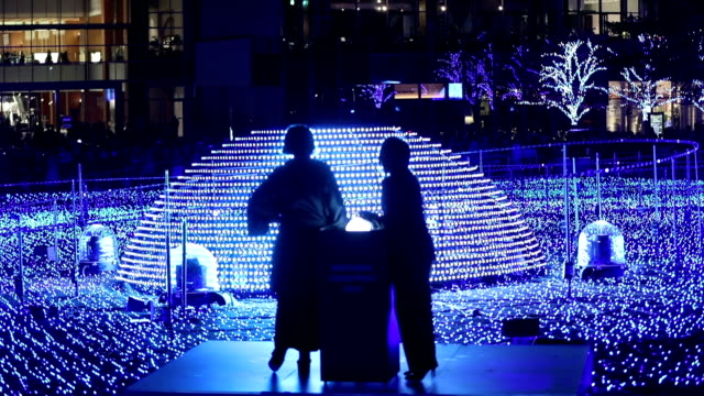 tokyo midtown, the popular commercial complex located in tokyo's roppongi district, ignited into a sea of blue on the evening of november 15 japan,... - tokyo midtown stock videos & royalty-free footage