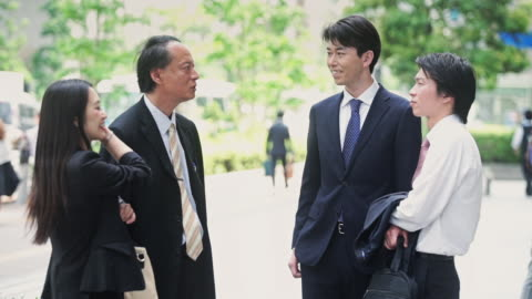 tokyo office workers chatting in street - mixed age range stock videos & royalty-free footage
