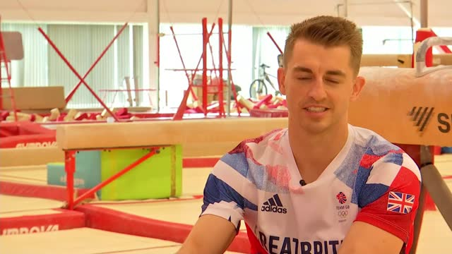 tokyo olympic games: max whitlock returns home to essex with pommel horse gold; england: essex: basildon: ext max whitlock arriving whitlock signing... - autographing stock videos & royalty-free footage