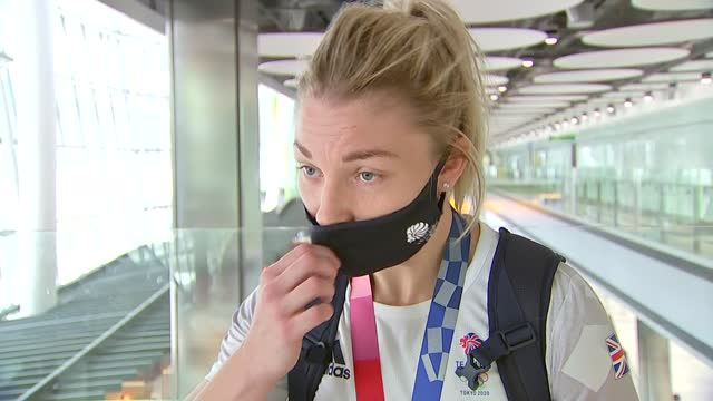 tokyo olympic games: team gb arriving at heathrow: arrivals interviews; england: london: heathrow airport: int lauren price speaking to members of... - autographing stock videos & royalty-free footage