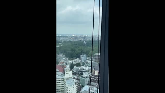 tokyo residents were treated to an unusual sight on july 16 when a giant floating head appeared over the city's yoyogi park. footage taken by masato... - human face video stock e b–roll
